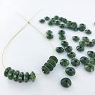 Wooden beads disc 7mm green